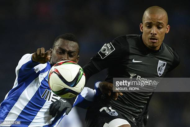 Porto's Colombian forward Jackson Martinez vies with Vitoria SC's defender Bruno Gaspar during the Portuguese Liga football match FC Porto vs Vitoria...