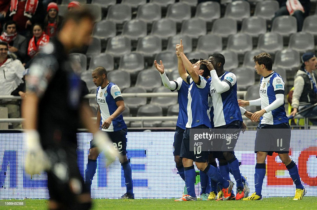 FC Porto's Colombian forward James Rodriguez (C) celebrates after scoring during the Portuguese League football match Braga vs Porto, on November 25, 2012, at Axa Municipal Stadium in Braga.