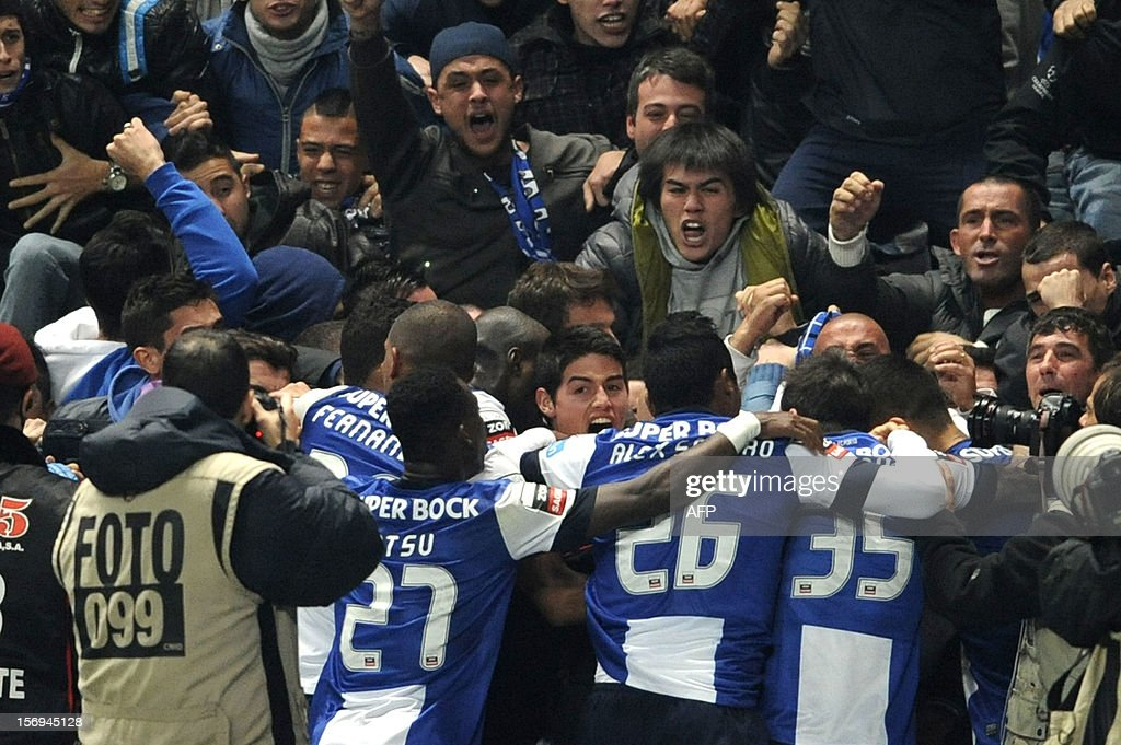 FC Porto's Colombian forward James Rodriguez (C) celebrates with teammates and supporters after scoring during the Portuguese League football match Braga vs Porto, on November 25, 2012, at Axa Municipal Stadium in Braga.