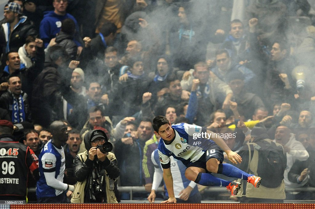 FC Porto's Colombian forward James Rodriguez jumps a fence after celebrating with teammates and supporters after scoring during the Portuguese League football match Braga vs Porto, on November 25, 2012, at Axa Municipal Stadium in Braga. AFP PHOTO / FERNANDO VELUDO