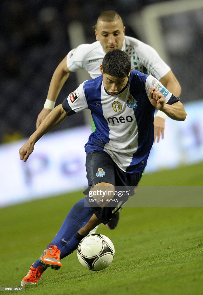 Porto's Colombian midfielder James Rodriguez runs with the ball chased by Moreirense's Algerian forward Nabil Ghilas during the Portuguese league football match FC Porto vs Moreirense at the Dragao Stadium in Porto on December 8, 2012. Porto won 1-0.