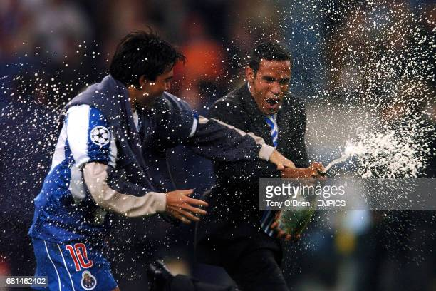 FC Porto's Deco celebrates victory over Monaco by spraying a magnum of Amstel