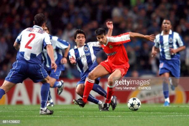 FC Porto's Deco tackles Deportivo La Coruna's Juan Valeron