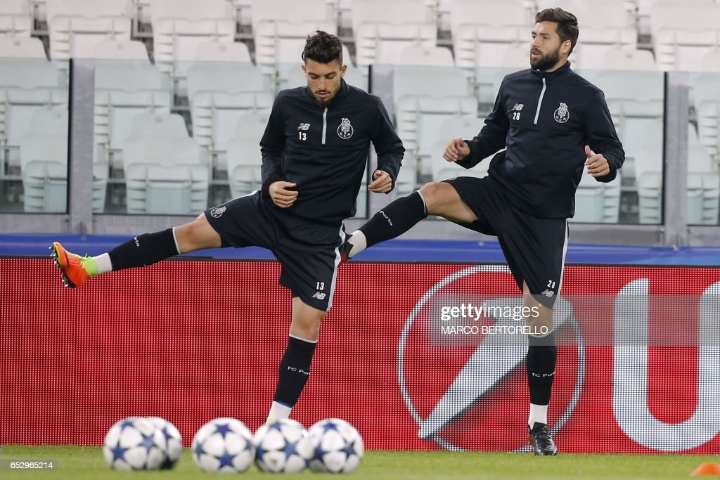 Porto's defender Alex Telles from Brazil (L) and Porto's defender Felipe from Brazil take part in a training session on the eve of the UEFA Champions League football match Juventus Vs FC Porto on M...