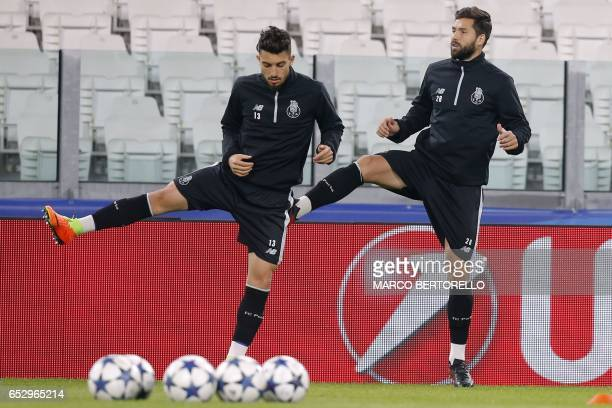 Porto's defender Alex Telles from Brazil and Porto's defender Felipe from Brazil take part in a training session on the eve of the UEFA Champions...