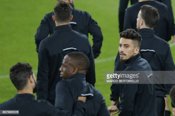Porto's defender Alex Telles from Brazil takes part in a training session on the eve of the UEFA Champions League football match Juventus Vs FC Porto...