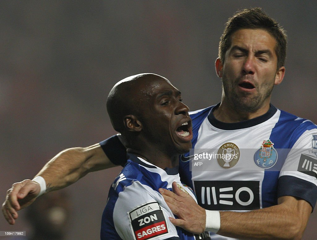 Porto's defender Eliaquim Mangala (L) celebrates with teammate Joao Moutinho after scoring during the Portuguese league football match SL Benfica vs FC Porto at Luz Stadium in Lisbon on January 13, 2013. AFP PHOTO/ HENRIQUES DA CUNHA