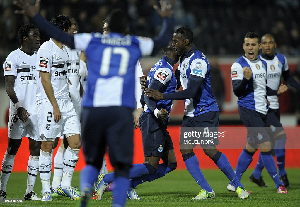 Porto's defender Eliaquim Mangala (C) celebrates with teammates after scoring the opening goal during the Portuguese league football match Vitoria SC vs FC Porto at the D.Afonso Henriques Stadium in Guimaraes on February 2, 2013.