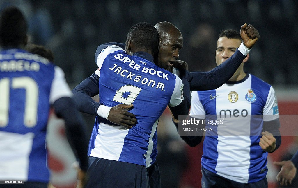 Porto's defender Eliaquim Mangala (CR) celebrates with teammates after scoring the opening goal during the Portuguese league football match Vitoria SC vs FC Porto at the D.Afonso Henriques Stadium in Guimaraes on February 2, 2013.