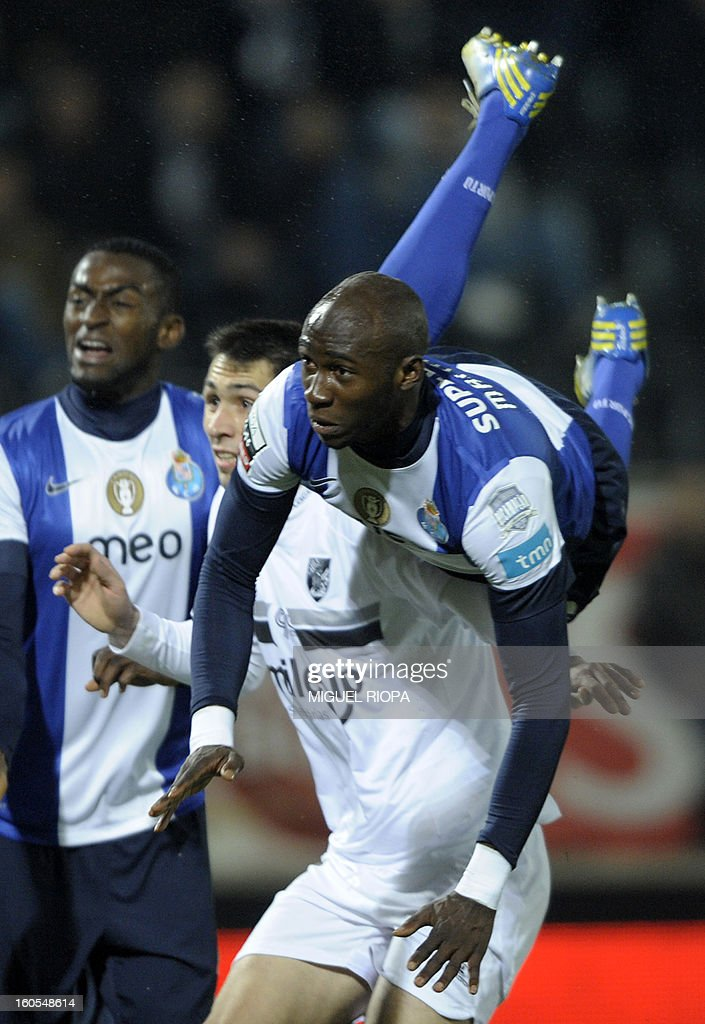 Porto's defender Eliaquim Mangala (R) falls after scoring the opening goal during the Portuguese league football match Vitoria SC vs FC Porto at the D. Afonso Henriques stadium in Guimaraes on February 2, 2013.