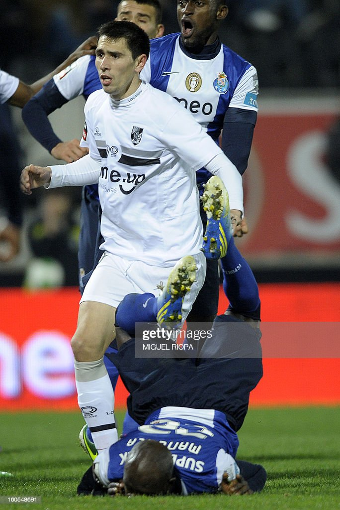 Porto's defender Eliaquim Mangala falls on the pitch after scoring the opening goal during the Portuguese league football match Vitoria SC vs FC Porto at the D.Afonso Henriques Stadium in Guimaraes on February 2, 2013.