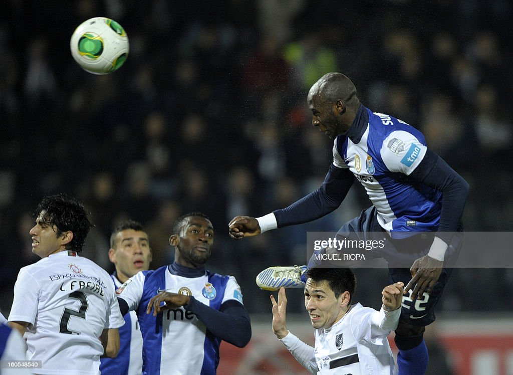 Porto's defender Eliaquim Mangala (R) heads the ball over Vitoria SC's defender Paulo Oliveira to score a goal during the Portuguese league football match Vitoria SC vs FC Porto at the D. Afonso Henriques stadium in Guimaraes on February 2, 2013.