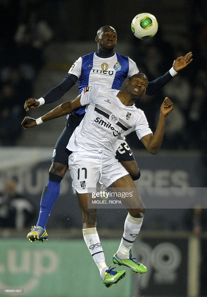 Porto's defender Eliaquim Mangala (Top) jumps for the ball with Vitoria SC's forward Amido Balde during the Portuguese league football match Vitoria SC vs FC Porto at the D.Afonso Henriques Stadium in Guimaraes on February 2, 2013.