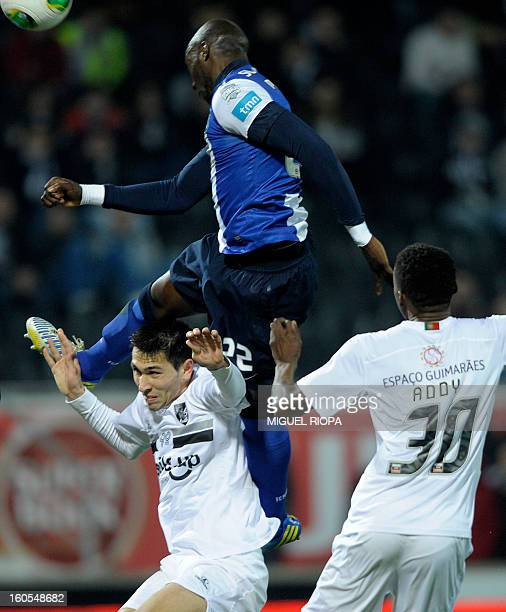 Porto's defender Eliaquim Mangala jumps over Vitoria SC's defender Paulo Oliveira to score the opening goal during the Portuguese league football...