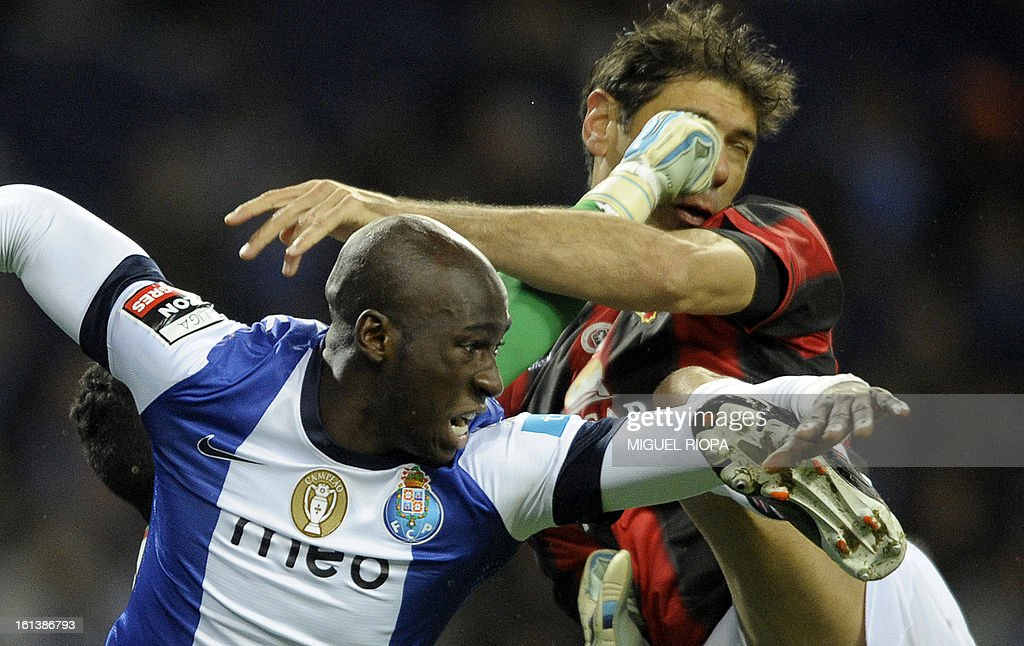 Porto's defender Eliaquim Mangala (L), Olhanense's Brazilian goalkeeper Rafael Bracalli (hidden) and Brazilian defender Mauricio jump for the ball during the Portuguese first league football match FC Porto vs Olhanense at the Dragao stadium in Porto, on February 10, 2013. The match ended in a draw 1-1.