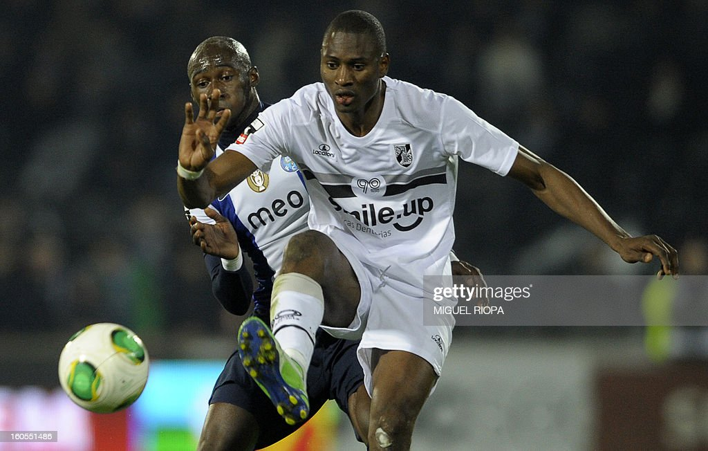 Porto's defender Eliaquim Mangala (L) vies with Vitoria SC's forward Amido Balde during the Portuguese league football match Vitoria SC vs FC Porto at the D.Afonso Henriques Stadium in Guimaraes on February 2, 2013.