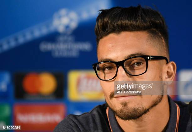 Porto's defender from Brazil Alex Telles looks on during a press conference at the Dragao stadium in Porto on September 12 2017 on the eve of the...