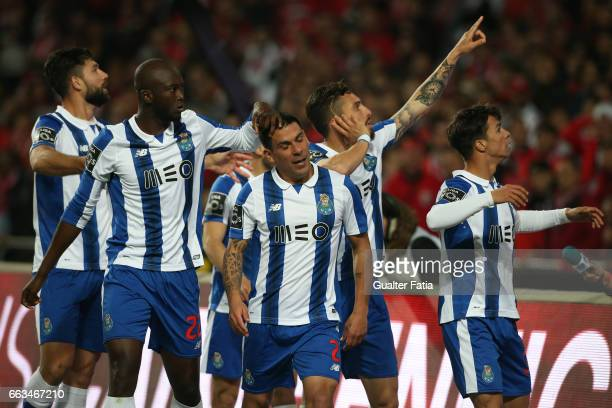 Porto's defender from Uruguay Maxi Pereira celebrates with teammates after scoring a goal during the Primeira Liga match between SL Benfica and FC...