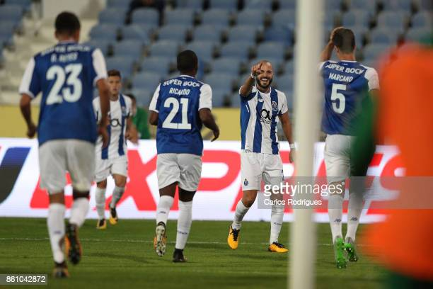 Porto's defender Ivan Marcano from Spain celebrates scoring Porto third goal with his team mates during the match between Lusitano Ginasio Clube and...
