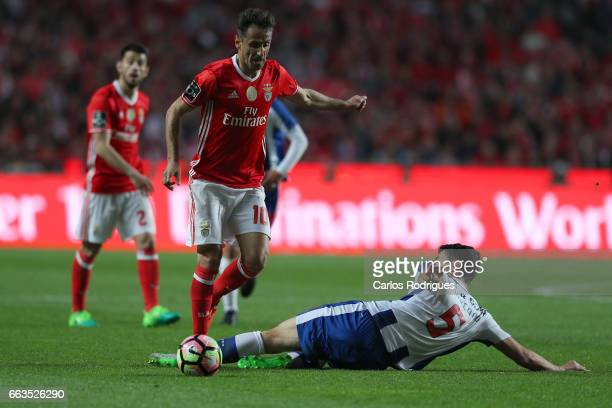 Porto's defender Ivan Marcano from Spain tackles Benfica's forward Jonas from Brasil during the match between SL Benfica and FC Porto for the...