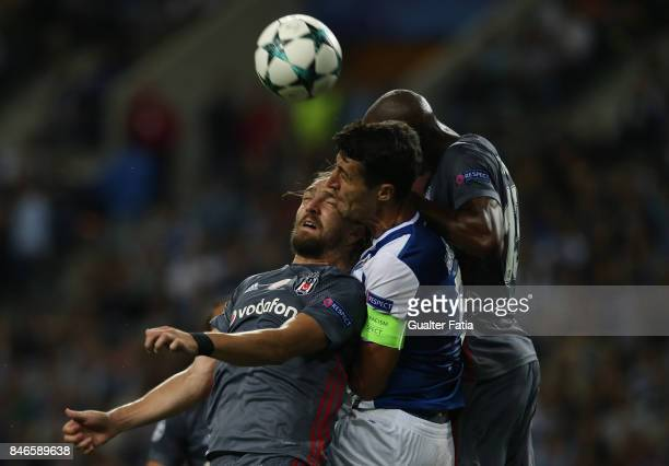Porto's defender Ivan Marcano with Besiktas defender Caner Erkin and Besiktas midfielder Atiba Hutchinson from Canada in action during the UEFA...