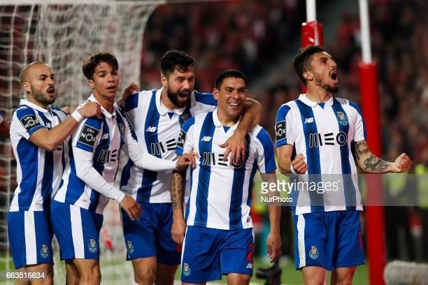 Porto's defender Maxi Pereira celebrates his goal with Porto's midfielder Andre Andre Porto's midfielder Oliver Torres Porto's defender Felipe...