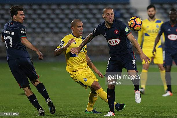 FC Portos defender Maxi Pereira from Uruguay and Belenensess midfielder Andre Sousa from Portugal during Premier League 2016/17 match between Os...