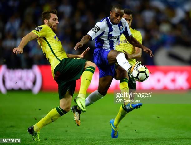 Porto's defender Ricardo Pereira challenges Pacos de Ferreira's defender Miguel Vieira during the Portuguese league football match FC Porto vs FC...