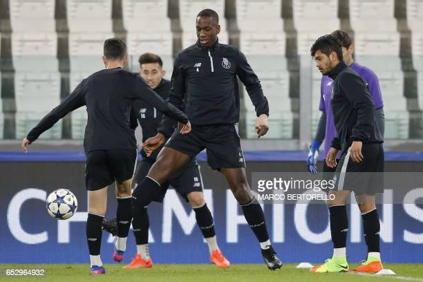 Porto's defender Willy Boly from France takes part in a training session with teammates on the eve of the UEFA Champions League football match...
