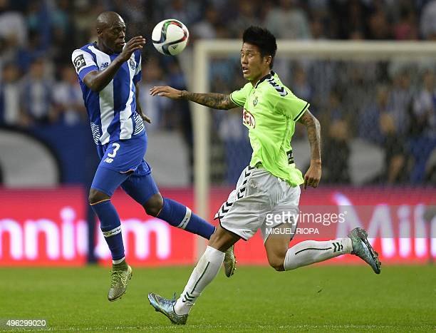 Porto's Dutch defender Bruno Martins Indi vies with Vitoria Setubal's Korean forward Suk Hyunjun during the Portuguese league football match FC Porto...
