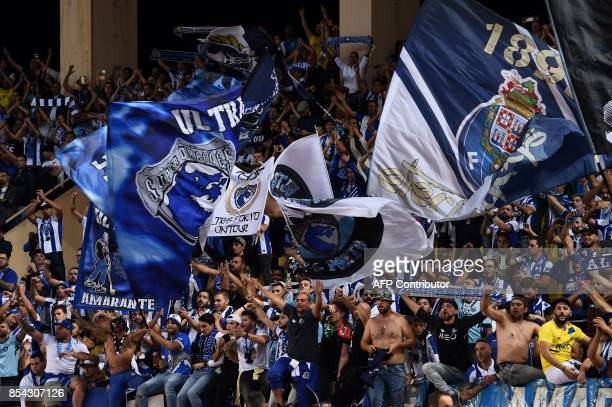 Porto's fans cheer for their team during the UEFA Champions League Group G football match AS Monaco FC vs FC Porto on September 26 2017 at the Louis...