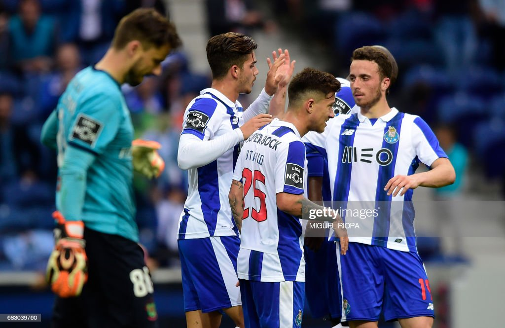 Porto's forward Andre Silva (2ndL) celebrates with teammates after scoring during the Portuguese league football match FC Porto vs FC Pacos de Ferreira at the Dragao stadium in Porto on May 14, 2017. Porto won 4-1. /