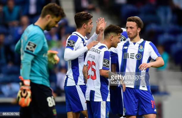 Porto's forward Andre Silva celebrates with teammates after scoring during the Portuguese league football match FC Porto vs FC Pacos de Ferreira at...