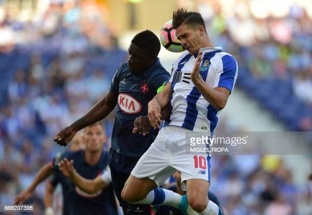 Porto's forward Andre Silva heads the ball with Belenenses' BissauGuinean forward Abel Camara during the Portuguese league football match FC Porto vs...