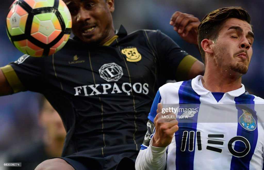 Porto's forward Andre Silva (R) jumps for the ball with Pacos de Ferreira's Cape Verdean defender Gege during the Portuguese league football match FC Porto vs FC Pacos de Ferreira at the Dragao stadium in Porto on May 14, 2017. Porto won 4-1. /