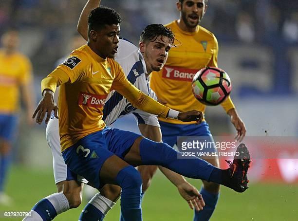 Porto's forward Andre Silva vies with Estoril's Brazilian defender Ailton Silva and Brazilian forward Kleber Pinheiro during the Portuguese league...