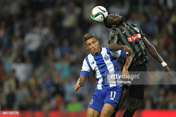 Porto's forward Cristian Tello vies with Guimaraes's midfielder Bouba Sare during the match between FC Porto and Vitoria Guimaraes for the Portuguese...