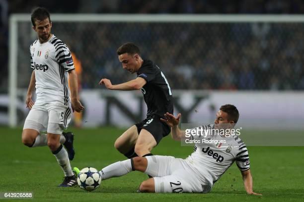 Porto's forward Diogo Jota from Portugal tries to escape Juventus' midfielder Miralem Pjanic from Bosnia and Juventus' forward Marko Pjaca from...