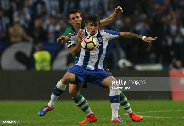 Porto's forward from Brazil Soares with Sporting CP's midfielder Joao Palhinha from Portugal in action during the Primeira Liga match between FC...