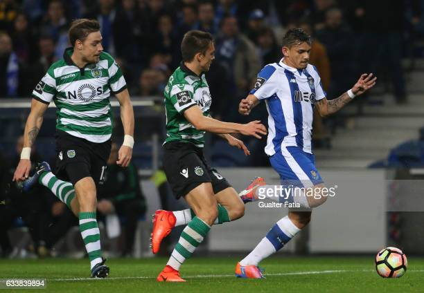 PortoÕs forward from Brazil Soares with Sporting CPÕs midfielder Joao Palhinha from Portugal and Sporting CPÕs defender Sebastian Coates from Uruguay...