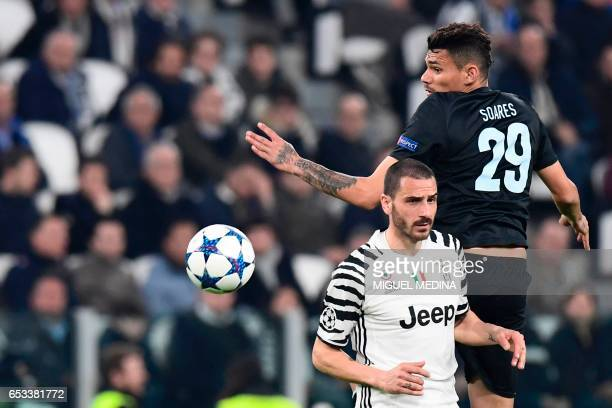 Porto's forward from Brazil Tiquinho Soarez jumps for the ball next to Juventus' defender from Italy Leonardo Bonucci during the UEFA Champions...