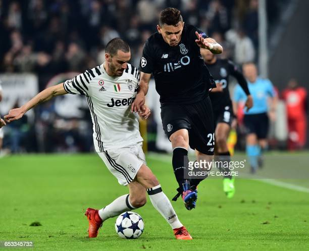 Porto's forward from Brazil Tiquinho Soarez vies with Juventus' defender from Italy Leonardo Bonucci during the UEFA Champions League football match...
