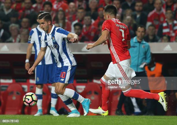 Porto's forward from Portugal Andre Silva with SL Benfica's midfielder from Greece Andreas Samaris in action during the Primeira Liga match between...
