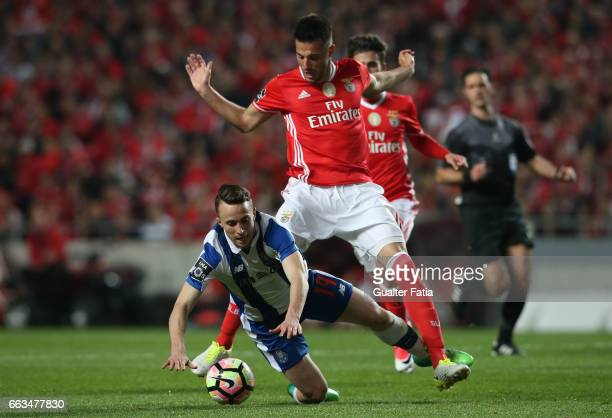 Porto's forward from Portugal Diogo Jota tackled by SL Benfica's midfielder from Greece Andreas Samaris during the Primeira Liga match between SL...