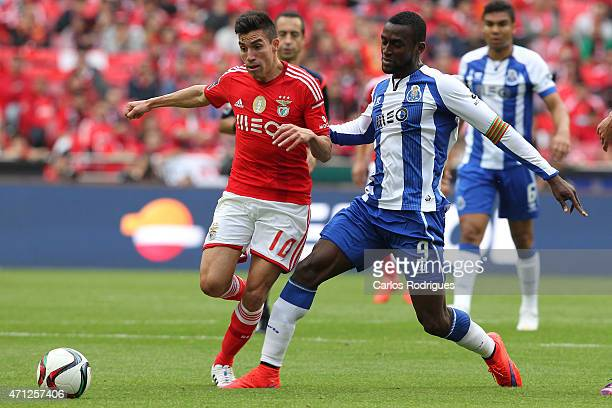 Porto's forward Jackson Martinez tackles Benfica's midfielder Nicolas Gaitan in action during the Primeira Liga match between Benfica and FC Porto at...
