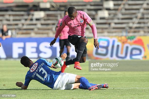 Porto's forward Jackson Martinez tries to pass trough Belenenses«s defender Joao Afonso during the Primeira Liga match between Belenenses and FC...