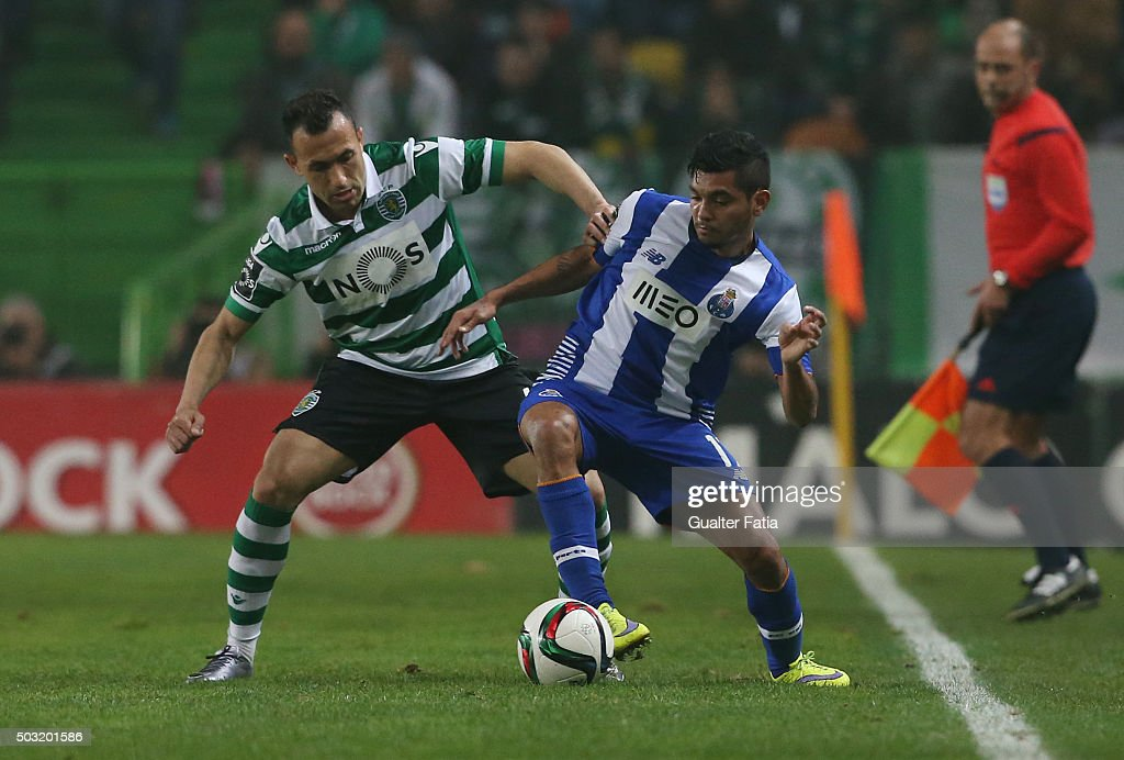 FC Porto's forward Jesus Corona with Sporting CP's defender Jefferson in action during the Primeira Liga match between Sporting CP and FC Porto at Estadio Jose Alvalade on January 2, 2016 in Lisbon, Portugal.