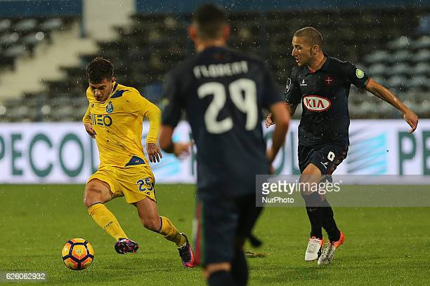 FC Portos forward Otavio from Brazil with Belenensess midfielder Andre Sousa from Portugal during Premier League 2016/17 match between Os Belenenses...