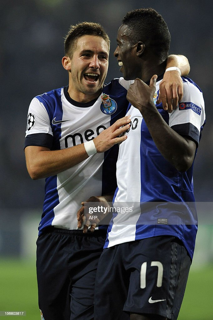 FC Porto's forward Silvestre Varela (R) celebrates with teammate midfielder Joao Moutinho (L) after scoring during the UEFA Champions League group A football match FC Porto against GNK Dinamo Zagreb on November 21, 2012, at Dragao Stadium in Porto.