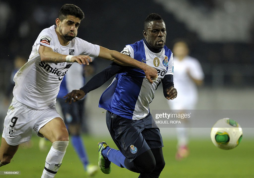 Porto's forward Silvestre Varela (R) vies with Vitoria SC's forward Marco Matias during the Portuguese league football match Vitoria SC vs FC Porto at the D. Afonso Henriques Stadium in Guimaraes on February 2, 2013. Porto won the match 4-0 and Colombian forward Jackson Martinez scored a hat-trick.